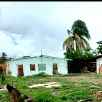 Chaguanas lot with vandalised house.