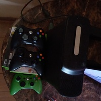 Xbox 360 with games and controls