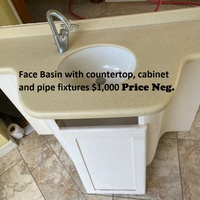 Face Basin with countertop, cabinet and pipe fixtures