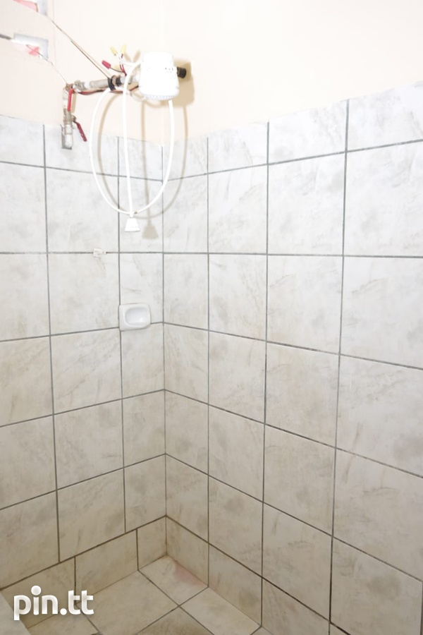 UPSTAIRS TWO BEDROOM APARTMENT IN CHAGUANAS-3