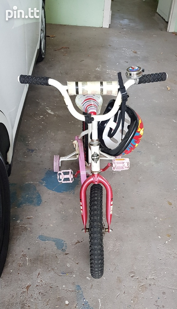 Huffy girls pink bike with support wheels and helmet-4