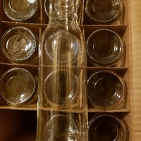 96 glass bottles and covers perfect for juices or other beverages.