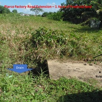 Potential for Condos/Townhouses/Warehouse- Piarco 1 Acre Freehold land