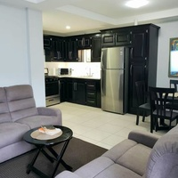 EXECUTIVE STYLE - Lovely 2 Bedrooms. FULLY FURNISHED, WIFI, CABLE, UTILITIES Inc