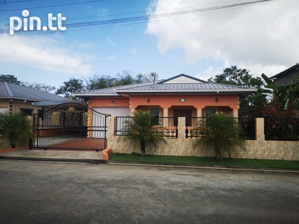 Lovely 3 bedroom home in peaceful residential Cunupia-1