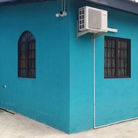 House with income generating unit