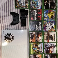 Xbox one, with all the games plus a controller and a charging port, used once
