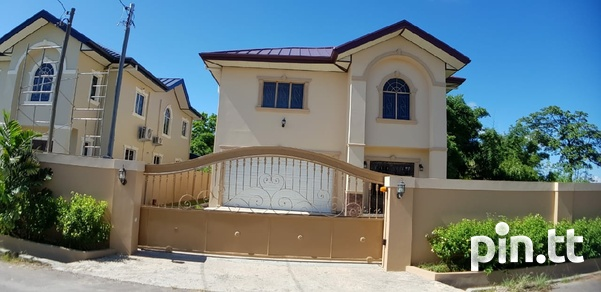 2 Couva homes side by side-1