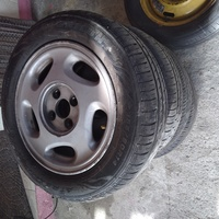 Three sets of rims and spare tyres