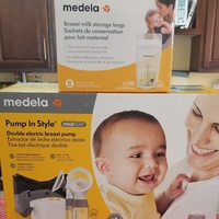Medela Pump in style, upgraded USA version + 100 storage bags.