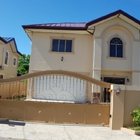 2 Couva homes side by side