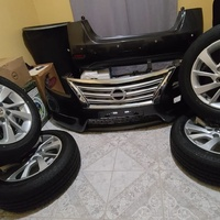 Nissan Sentra OEM 16 rims with tyres, front and rear bumpers combo