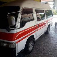 Red Band Nissan Maxi Taxi