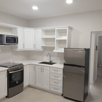 Apartment with appliances in gated compound