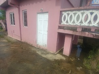 Upstairs house with 2 bedroom incomplete apartment downstairs cumuto