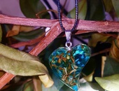 Beautiful handcrafted heart shaped aqua blue resin pendant