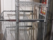 Commercial metal stand with drawers