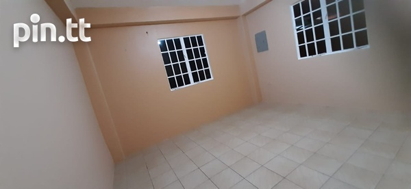 Unfurnished 2 bedroom apartment in Roystonia behind Couva Convent.-1