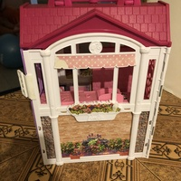 Original Barbie Dream House and Pink Glitter Shoes.