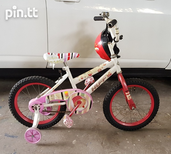 Huffy girls pink bike with support wheels and helmet-1