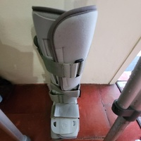 Pair of crutches and air boot cast all new.