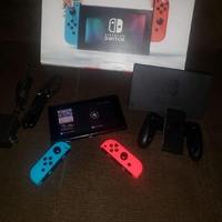 Nintendo Switch and two games