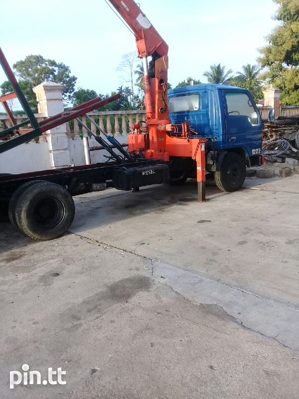 Madza 4 ton wrecker with crane and bucket attachment-1