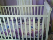 Large White Crib with attachments to convert to toddler's bed.